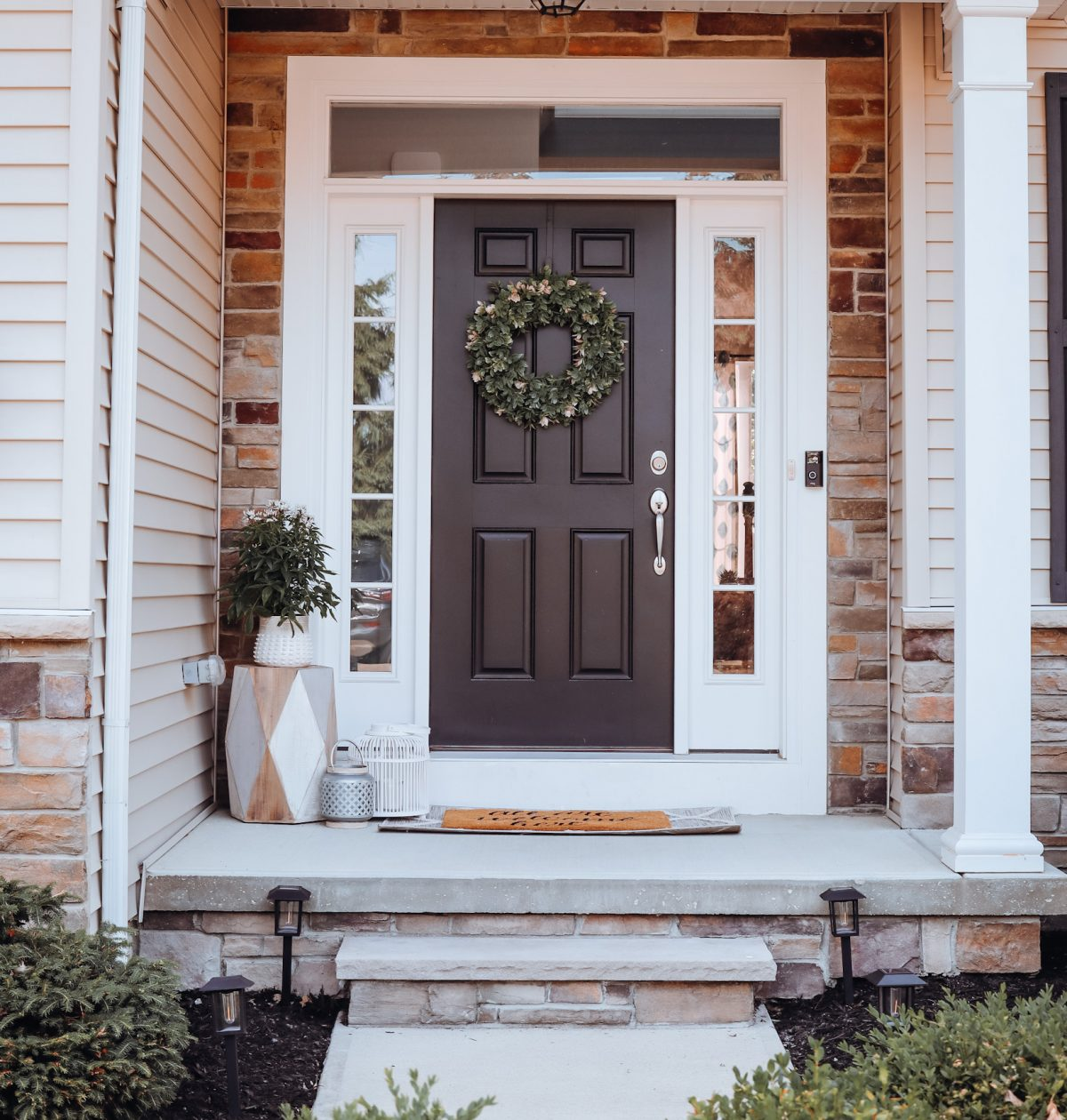 A picture of a small front porch with front porch decor.