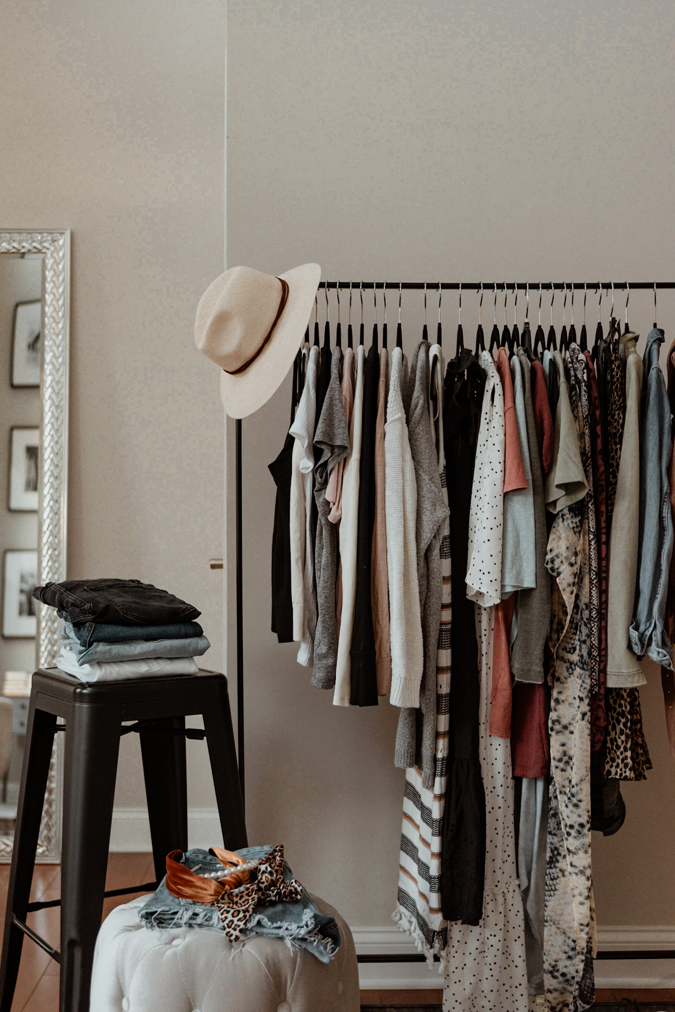 A sample capsule wardrobe including jeans, t shirts, sweaters, dresses, and accessories.