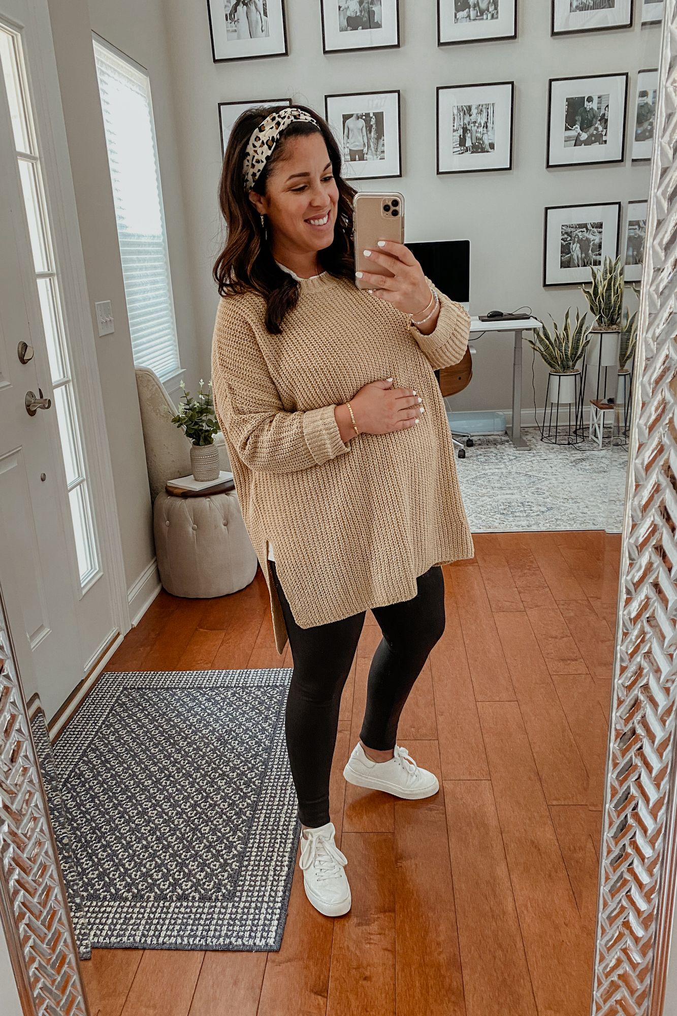 Meach wearing a fall maternity outfit including faux leather maternity leggings and an oversized maternity sweater.