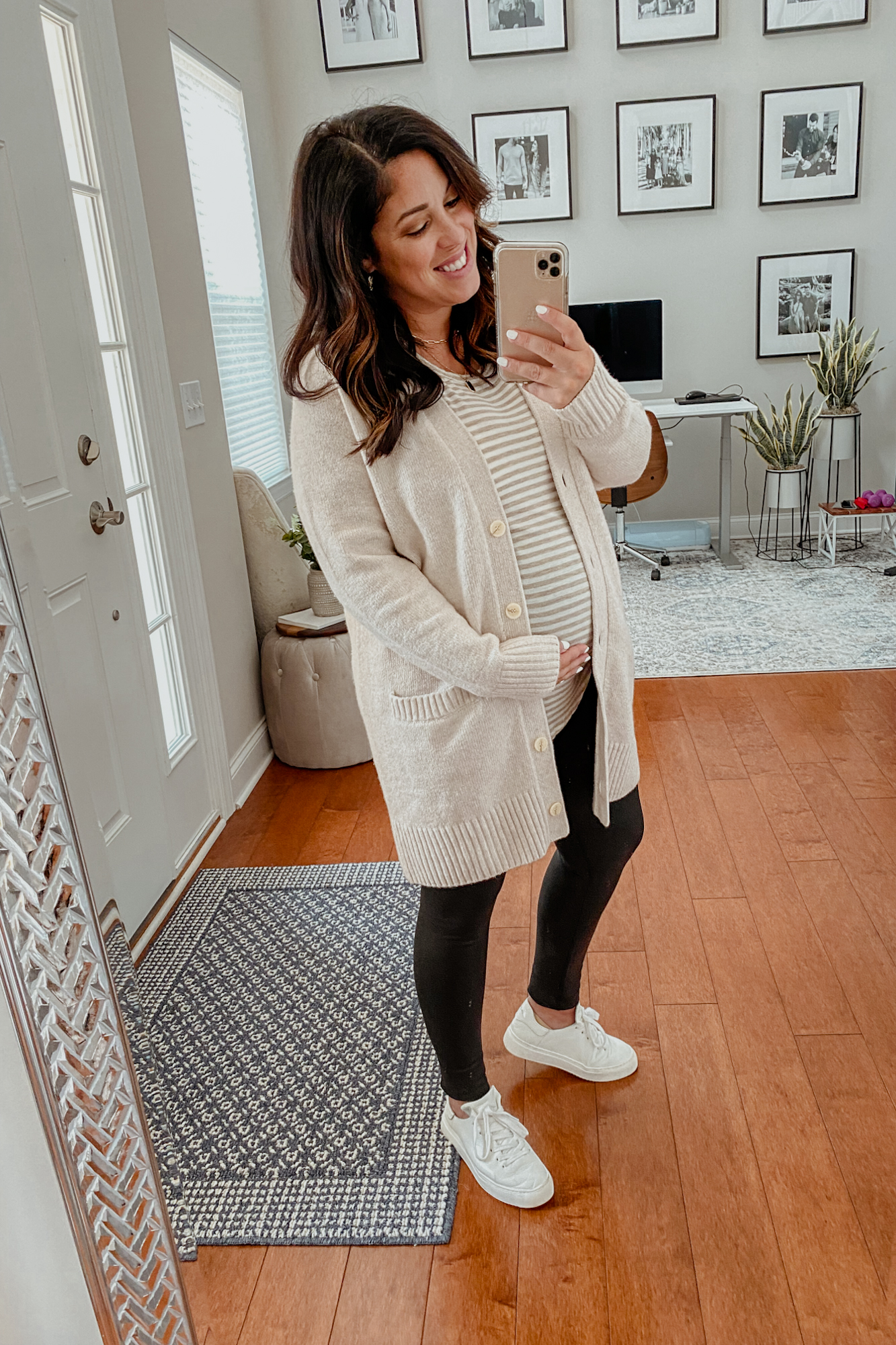 Maternity capsule wardrobe outfit inspiration including faux leather maternity leggings and a basic striped maternity t shirt.