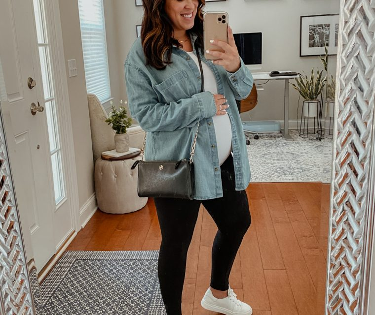 Meach wearing petite-friendly maternity clothes including black maternity leggings and a white maternity t shirt.
